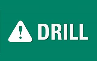The word DRILL! on a green sign