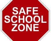 The words SAFE SCHOOL ZONE in a red stop sign frame